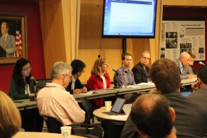 A panel of researchers and city representatives react to research findings about distributed transportation futures.