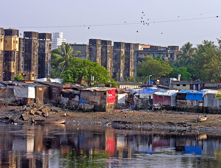 Informal housing along the banks of a waterway in India typical of the types of housing that require upgrading through inclusive development policies.