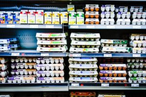 Eggs on display in a grocery store aisle.