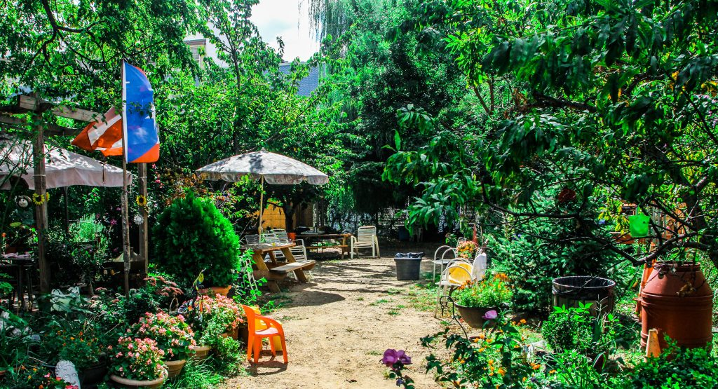 A picture of lush garden with seating areas in East Harlem, New York City.